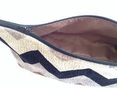 Zippered, pouch, bag, bathroom tote has a soft exterior and a fully lined interior.  Great for traveling even if its to and from the bathroom.