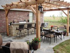 Like the setup with higher counter and area to Q with dining area separate with pergola.  Pictures of Outdoor Kitchens: Gas Grills, Cook Centers, Islands & More : Outdoors : Home & Garden Television