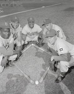 Brooklyn infield players as they group around bat and ball diamond. They are Jackie Robinson, Gil Hodges, Roy Campanella, Billy Cox, and Pee Wee Reese.1952