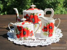 from The Tea party Company flower collection, red poppy teapot set @homegoods.com we have a teacup & saucer matching set.