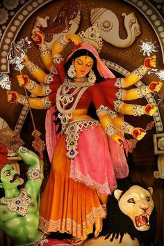 Godess DURGA,kiling goblin green Mohisasura.Every year in WestBengal,millions of puja pandals and idol created in every corner of BENGAL IN october.huge celibration for we