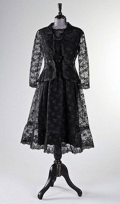 The Givenchy haute couture black chantilly lace cocktail dress, worn by Audrey Hepburn in `How to Steal a Million', 1966.