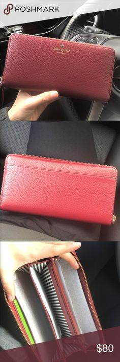 Kate spade wallet Kate spade wallet new with tag price is firm  FEATURES zip around continental wallet 12 credit card slots, 2 billfolds, zipper change pocket and exterior slide pocket DETAILS 7.6 w x 4.0 h x 0.8 d imported kate spade Bags Wallets