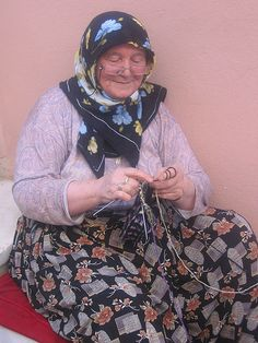 Woman Knitting socks. Love this woman who are knitting this sock.