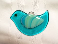 This adorable little fused glass birdie is just the thing for your adorning Christmas tree, hanging in your window, tying onto a gift, or