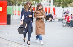 Left, a white blouse is paired with an embroidered cape, trousers, an Hermes Kelly bag, pumps, and round sunglasses. Right, Miroslava Duma wears a brown trench coat, cuffed jeans, white sneakers, and a crocodile black bag