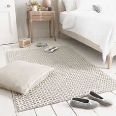 """BOBBLE RUG This hand-knotted piece topped the charts in our office vote for favourite rug. It's interesting whilst not being too """"out there"""". And it has a lovely bluey grey colour which manages to still be neutral."""