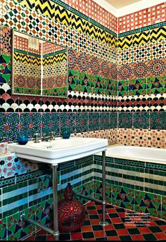 Bathroom tiled in multiple patterns gives it a real Bohemian feel