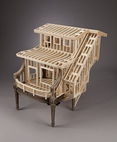 Is it a chair? Is it a dollshouse? Whatever it is its beautiful and somehow satisfying