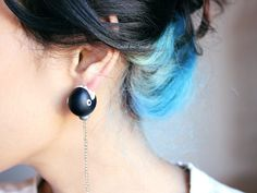 Two Things: Black Hair with Blue Layers Underneath (LOVE IT!), and Monster Earring Eating the Ear (DOUBLE LOVE IT!)
