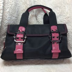 Franco Sarto Small Black Purse Franco Sarto Small Black Purse with Magenta accents. Short adjustable straps. Dark pewter metal hardware. Three compartments. Center and one side close with zippers. Other side has flap that closes with magnets. 11 x 3 x 6.  Fabric Franco Sarto Bags