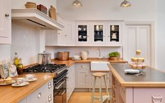 Painted shaker-style kitchen  Pink island, island unit, painted units, range cookers, wooden worktops, vintage style