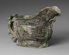 Spouted ritual wine vessel (guang), Shang dynasty, early Anyang period (ca. 1300–1050B.C.), 13th century B.C. Possibly Anyang, Henan Province, China Bronze; W. 13 in. (33cm) Collection of the Metropolitan Museum of Art