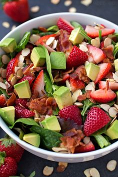 This strawberry avocado & spinach salad is so light and refreshing! It's topped with toasted almonds and bacon crumbles for crunch and a sprinkle of mozzarella cheese.