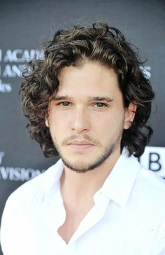 Kit Harington is a curly dude who plays Jon Snow in The Games of Thrones. Below are pictures of Kit Harington curly hair. He usually wears his curls at a medium length to long length, and according to John Snow, Messy Curly Hair, Curly Hair Styles, Pretty People, Beautiful People, My Champion, My Sun And Stars, Raining Men, Celebrity Crush