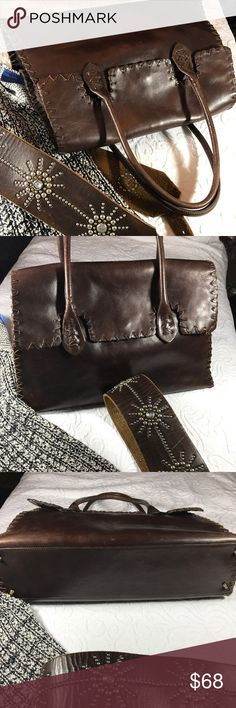 """All Leather Boho Whipstitch 💼 Bag A very loved all leather over the shoulder bag by Tano. Whipstitching all around the bag. Interior silky clean with zipper pocket with credit card slots and another leather pocket for glasses. Great size to carry larger wallet plus size phone makeup bag and more! Some minor wear at the corners and some scratches. Please see photo. But they lend to the charm of the style. Bottom is clean. Little Brass feet at the bottom. Height 10"""", max width 16.5, handle…"""