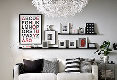 Install Photo Ledges: If there arent any surfaces left for you to put photos on, create some! Mount these black Ikea RIBBA photo ledges ($10) on your wall for a stylish yet practical touch.