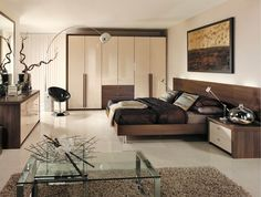 Contemporary bedroom with modern high gloss cream wardrobes and eye-catching furnishings.
