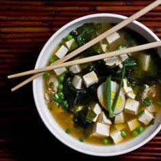 Miso broth with tofu, sho-yu tamago (soy sauce egg), seaweed, green onions, and peas
