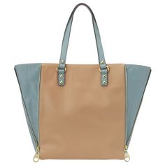 """Color block tote with zipper detail. Inside features single zip and dual slip pockets. Measures approx. 16"""" L x 13.5"""" H x 5"""" D."""