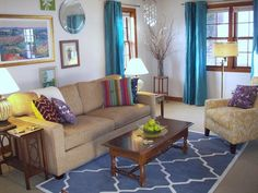 Love the yellow chair and the teal drapes