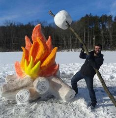 snow marshmallow roasting over a snow fire