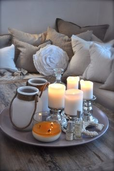 Various candles gathered on a tray on a coffee table