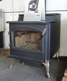 Quadra-Fire 5700 Wood Stove  - we can light this up for you in our showroom.