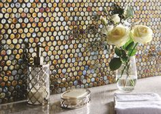 Cora glass penny round mosaics provide a change from the standard square shape. These iridescent tiles can be used to add a sense of opulence thanks to their warm tones. originalstyle.com