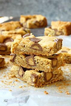 Peanut Butter Cup Blondies rich peanut butter cookie dough filled with peanut butter cups, delicious and chewy, you'll love this classic flavor combination.
