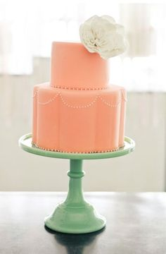 Pink cake on a jadite stand