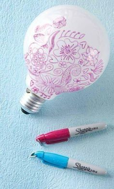 Draw sharpie on on a light bulb to get cool designs on your walls, cheep and easy