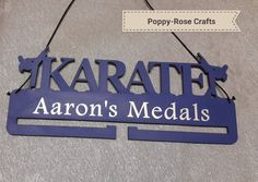 Karate medal holder. Personalised to order. Available from Poppy-Rose Crafts on Facebook