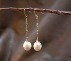 white pearl earrings - dangles on ear hooks  with gold chain - bridal or everyday jewelry by sticksandstonesny on Etsy https://www.etsy.com/listing/91613507/white-pearl-earrings-dangles-on-ear