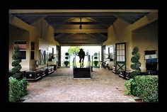 An equine treadmill sits in the breezeway between two aisles of this farm in Wellington, Florida.