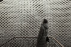 This Hand-Laid Brick Feature Wall Was Inspired by Soundwaves in Water