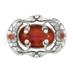 Sterling Silver and Amber Brooch, Georg Jensen   One oval cabochon amber ap. 30.0 x 19.0 mm., signed Georg Jensen, Denmark, 169, c. 1905, ap. 13.6 dwt.