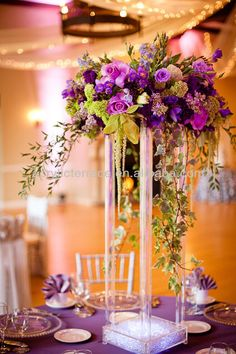 Tall plexiglass stands for centerpieces on the floor instead of on tables.