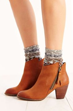 Heeled boots have became extremely popular recently and are seen on everyone. A must have for this Fall. Colors such as tan, taupe, beige and black. Elena A.