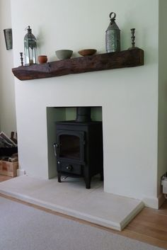 A Clearview Pioneer 400 in metallic black. A 1940s tiled monolith of a fireplace removed; fire chamber lined; new mantle in tudor oak - linseeded and looking lovely - set on top of a lovely Bathstone hearth. In an extended bungalow in a quiet, peaceful corner of Farnham, Surrey : Hilary you have the greenest fingers and the most beautiful garden.