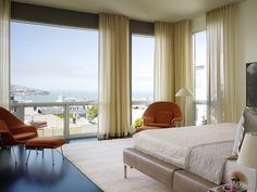 Astonishing Curtain Ideas for Large Windows at Home: Lovely Bedroom With View In Modern With Cream Curtain Ideas For Large Windows Decorated With Orange Chairs And Footboard At Both Corner ~ SFXit Design Furniture Inspiration