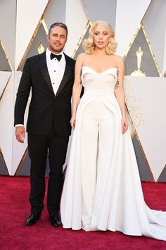 Taylor Kinney and Lady Gaga at the 88th Academy Awards