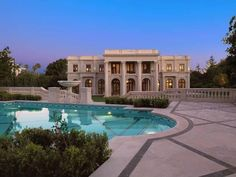 The house has a delicate hand carved imported limestone exterior, onyx marbles, marble columns contributing to the French architectural style.