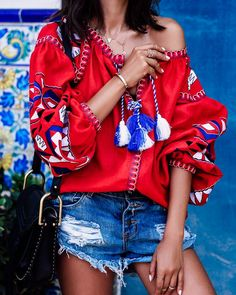 Casual summer outfit: denim shorts + red embroidered bohemian top