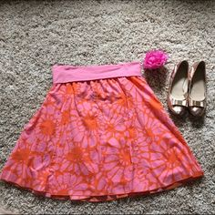 J Crew pink Flowy Skirt  Adorable lined skirt with pink and orange florals. Lined as shown in pic 2. Fold over stretchy waistband. EUC. Please give it a new home! Waist is 34 all the way around but easily stretches to 40. Length is 22. Freshly washed. Ready to be flaunted! Pair with a white top and some gold sandals!  J. Crew Skirts Midi
