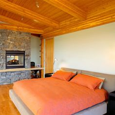 A Pop of Color    In a simple room, add a burst of color, like this orange bedding, to turn rustic into chic