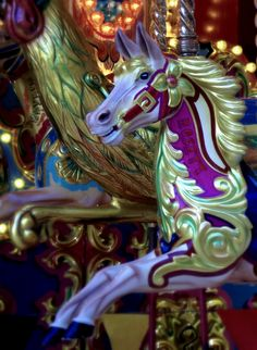 One of the many brightly painted horses of the carousel at the Trafford centre