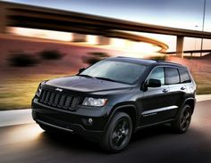 Jeep Grand Cherokee Stealth -- Only American SUV even worth considering.LOVE although I'd do different rims and prolly white but black works too