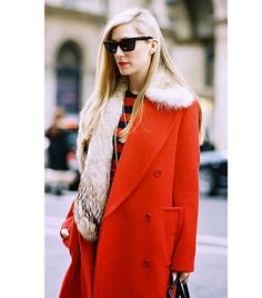 Sleek hair, red coat with fur stool and a touch of stripes. #style