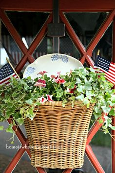 Patriotic basket with flags, petunias and transferware platter | homeiswheretheboatis.net #pottingshed #july4th